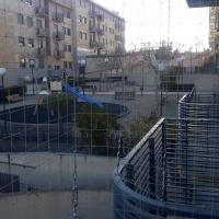 Protección para niños en balcón